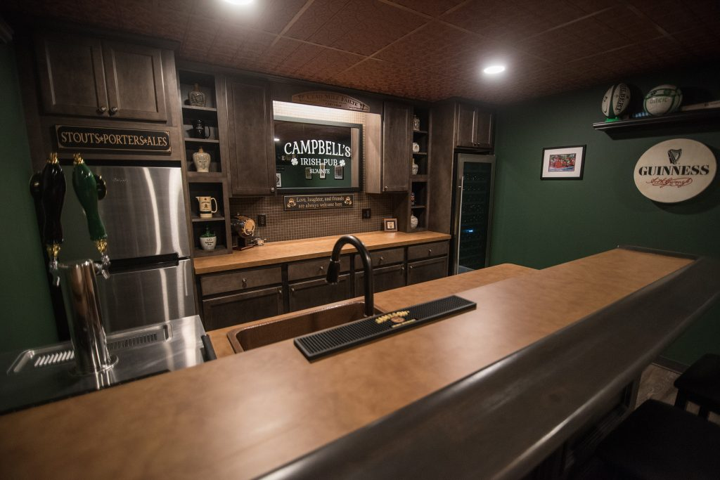 custom finished basement bar with Irish bar