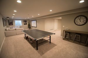 ping pong table in finished basement in brighton michigan with large living room