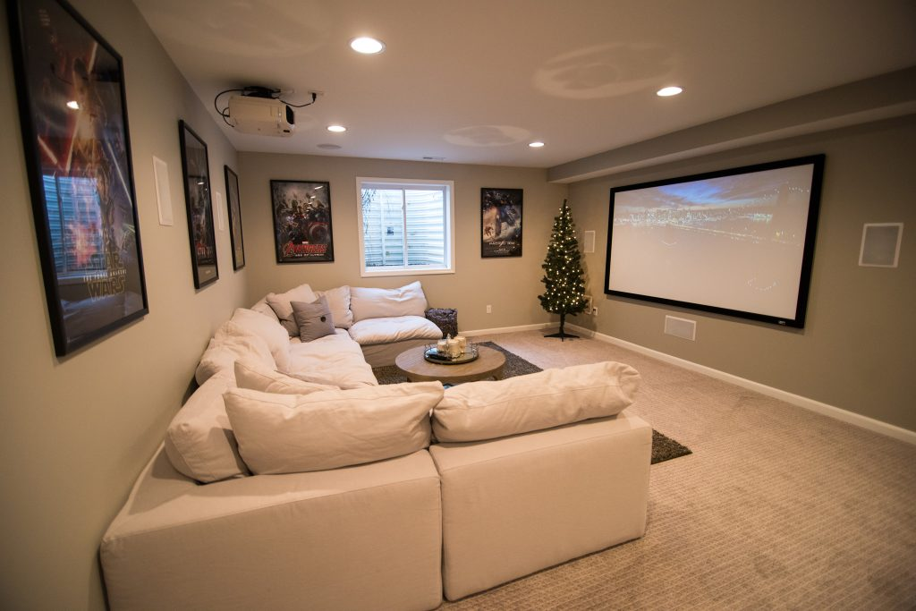 bright light grey basement with carpet and large sectional