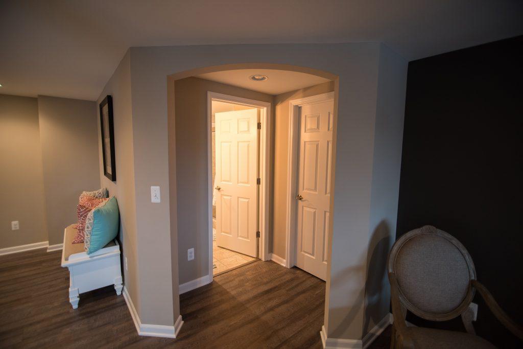 archway in basement hallway into bathroom