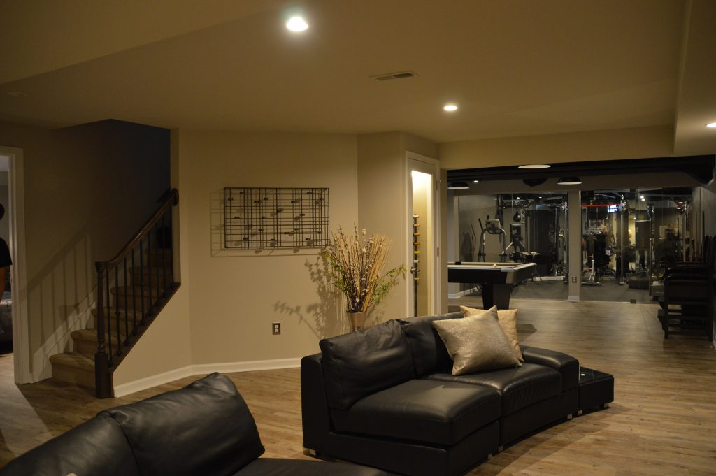 open concept basement living room with sofas