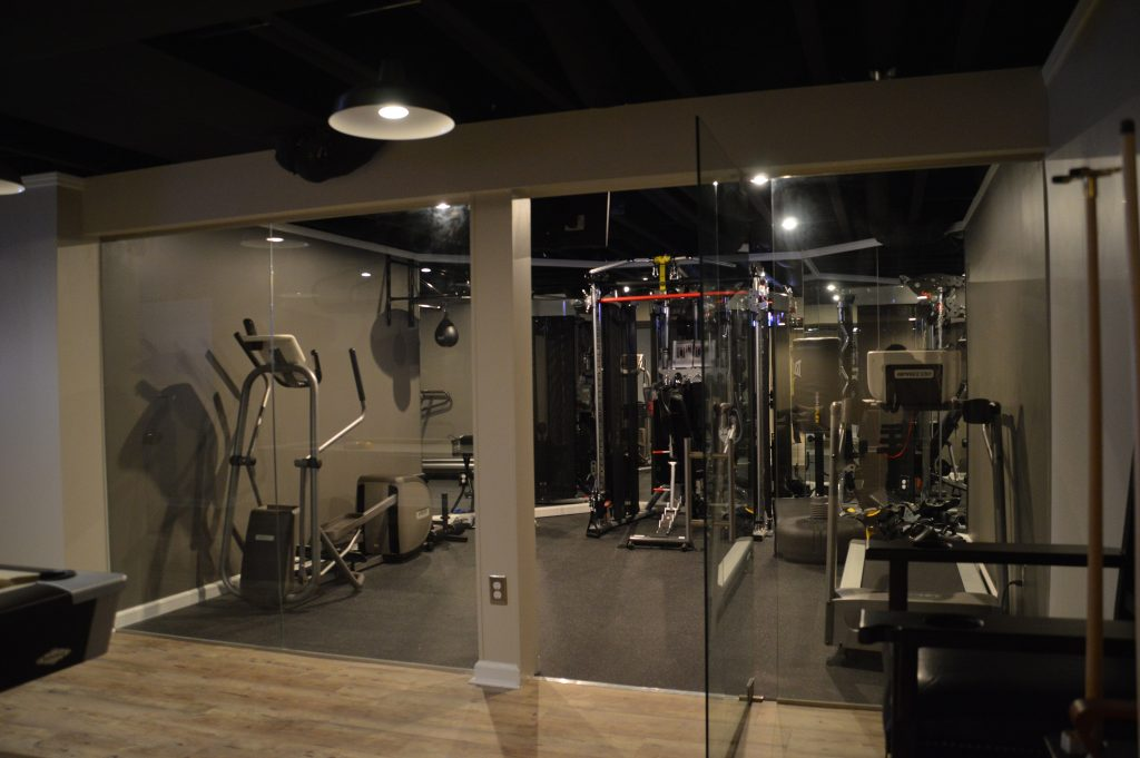 basement fitness room with glass walls for open views