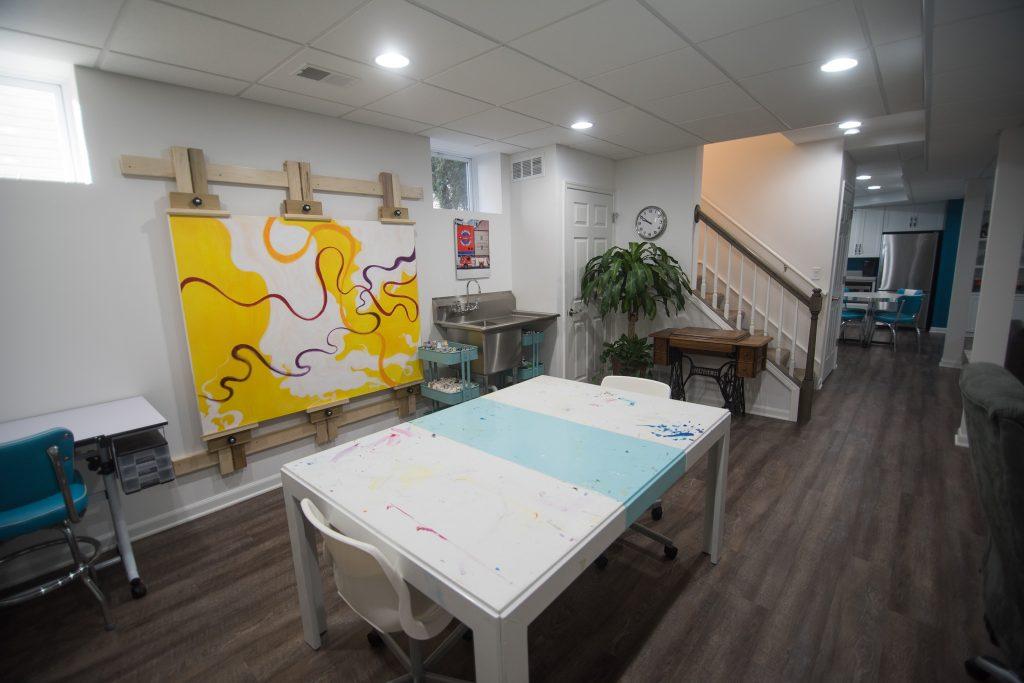 custom built basement art studio with washing sink