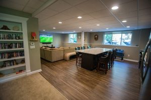 basement kitchen with vinyl plank flooring and a large island with seating