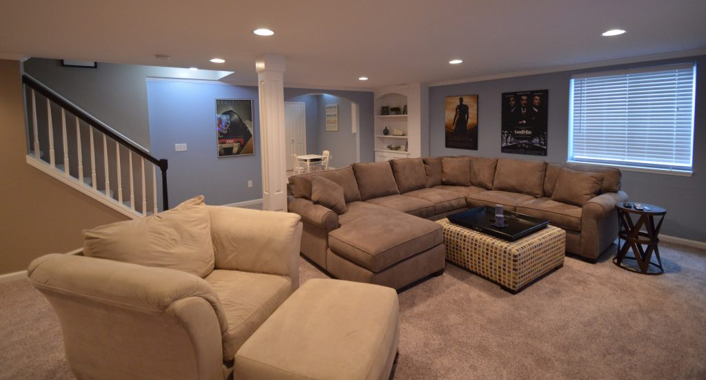basement living room with plenty of couches and seating
