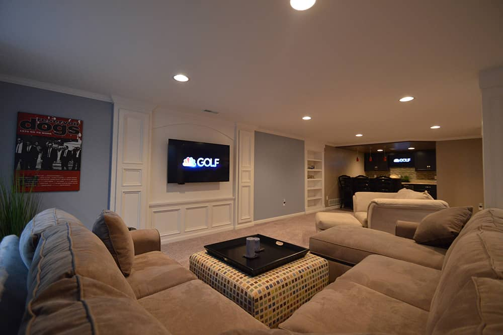 living room in basement with detailed media center design