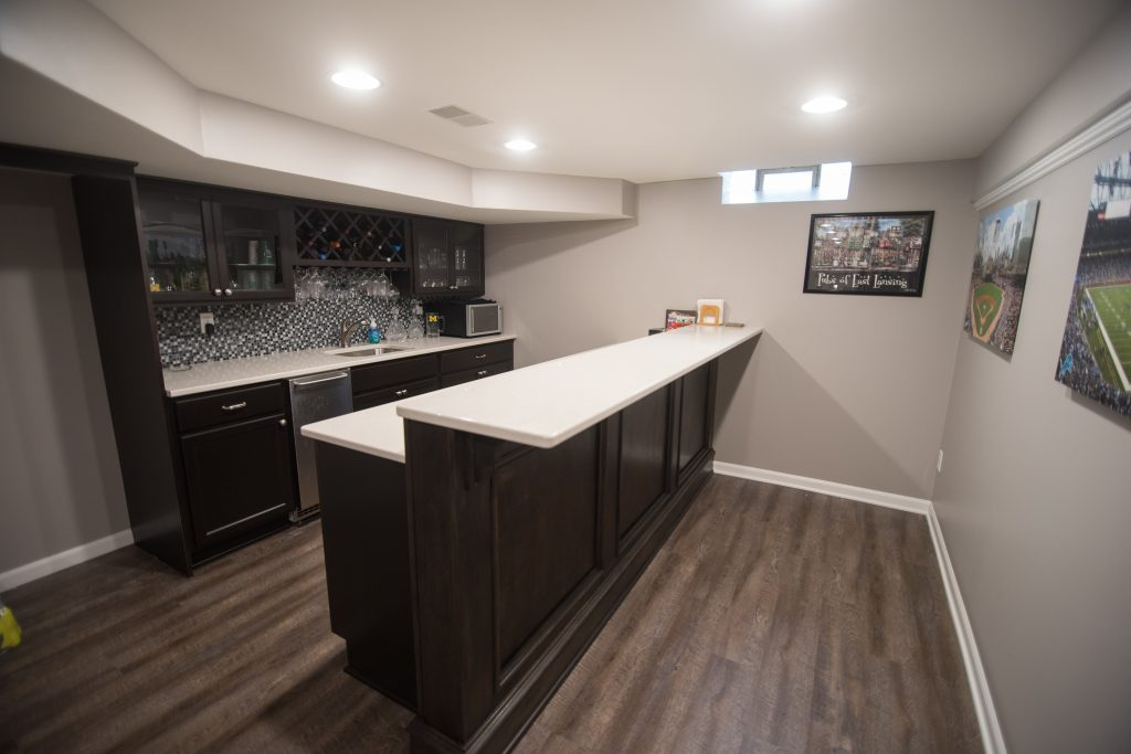 White granite countertops with dark stained cabinets