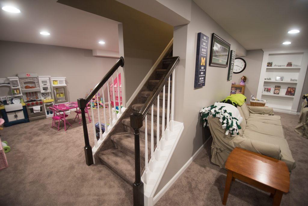 basement staircase with open rails leading to basement