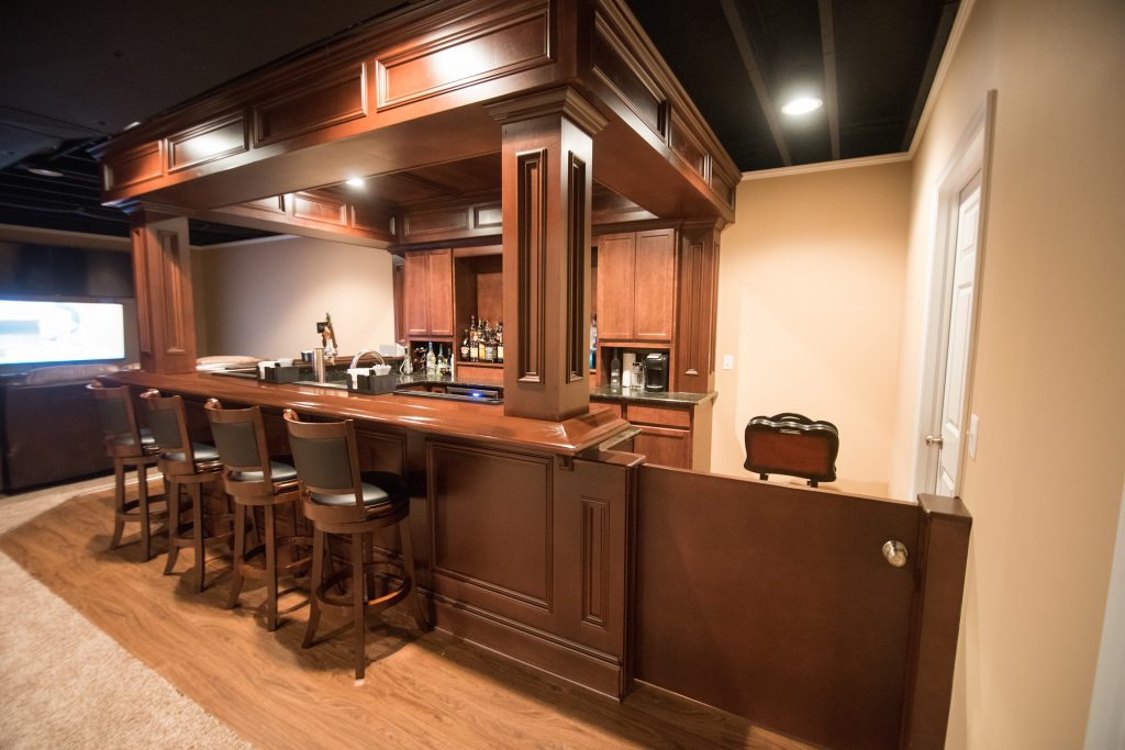 basement bar with soffet and stained wood