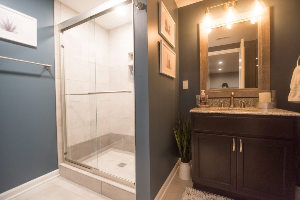 basement bathroom with full shower