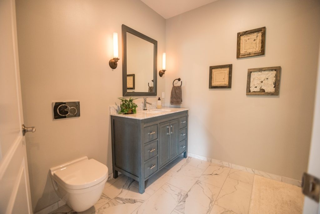 tile flooring in basement bathroom with blue vanity