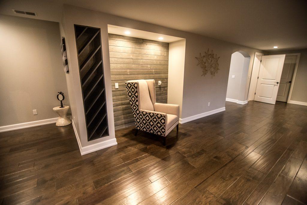 shiplap niche for basement office with dark wood flooring
